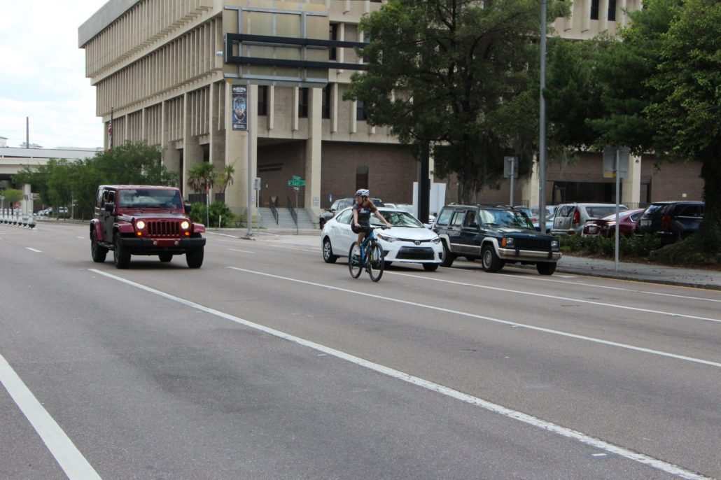 Photo of FDOT professional safely changing lanes on her bicycle in Downtown Tampa.