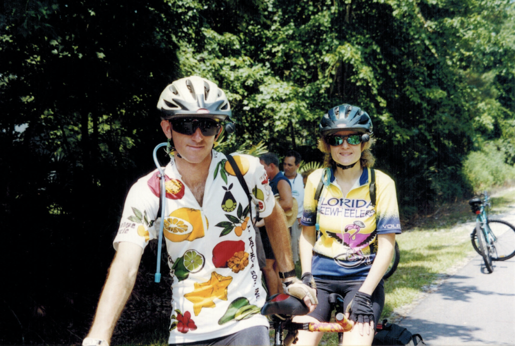 Photo of Mighk & Carol Wilson on their tandem bicycle, celebrating the grand opening of the Cross Seminole Trail with the Florida Freewheelers.
