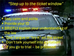 Picture of police car with text about handling a traffic stop on your bike.