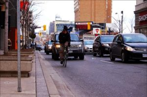"""Riding in the """"right tire track"""" in a travel lane can encourage unsafe passing."""