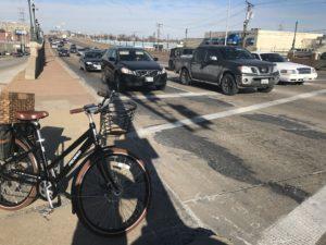 e-bike on sidewalk overlooking next traffic wave.