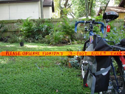 rigid three-foot ruler on bicycle