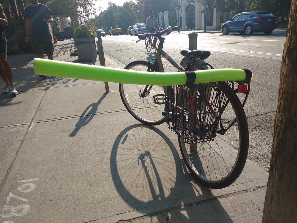 pool noodle attached to bicycle