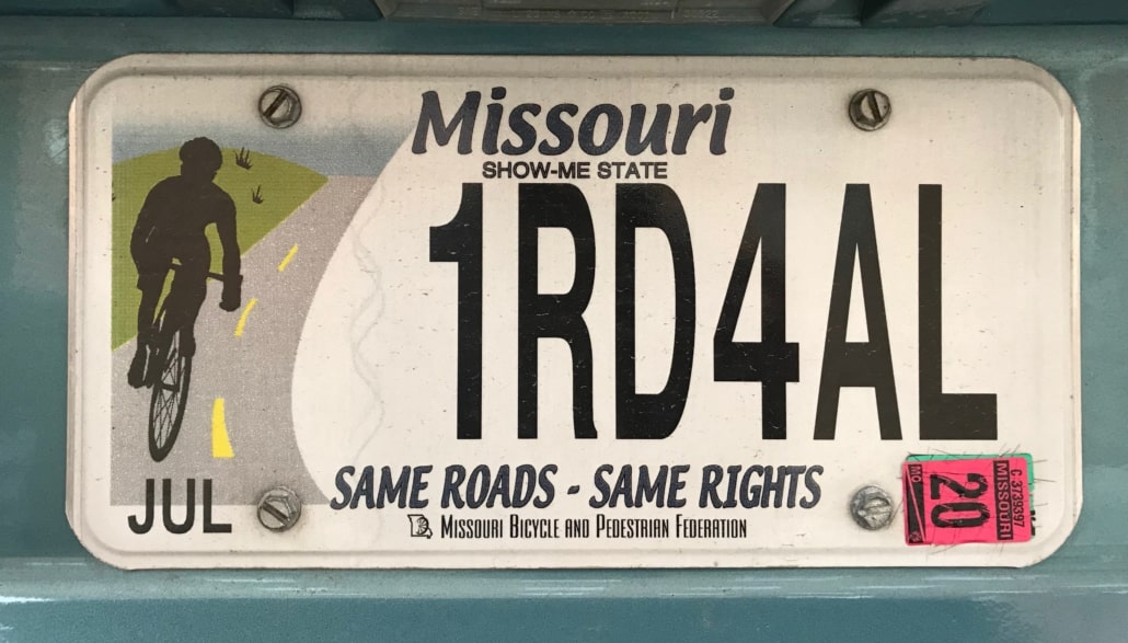 """Missouri license plate that reads """"One road for all"""""""