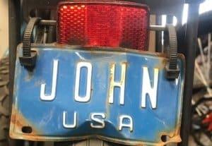 "Blue bicycle license plate ""John"""