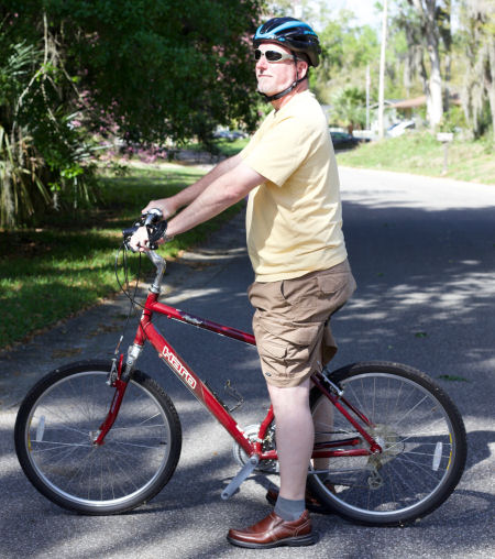 Adult student on bicycle with pedals removed