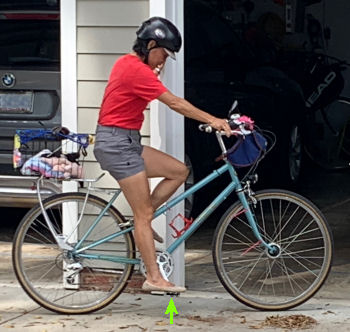 Pam Murray demonstrates a bicycle which is slightly too big.