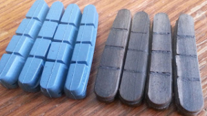 bicycle rim brake pads, new and worn, which are unsafe