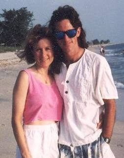 Photo of Carol & Mighk Wilson from 1993, shortly after they met, standing on a beach in Casey Key, FL.