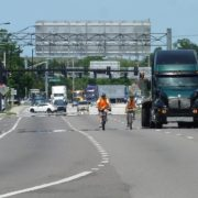 Photos shows FDOT staff on their bicycles avoiding a bike lane that is unsafe to use.