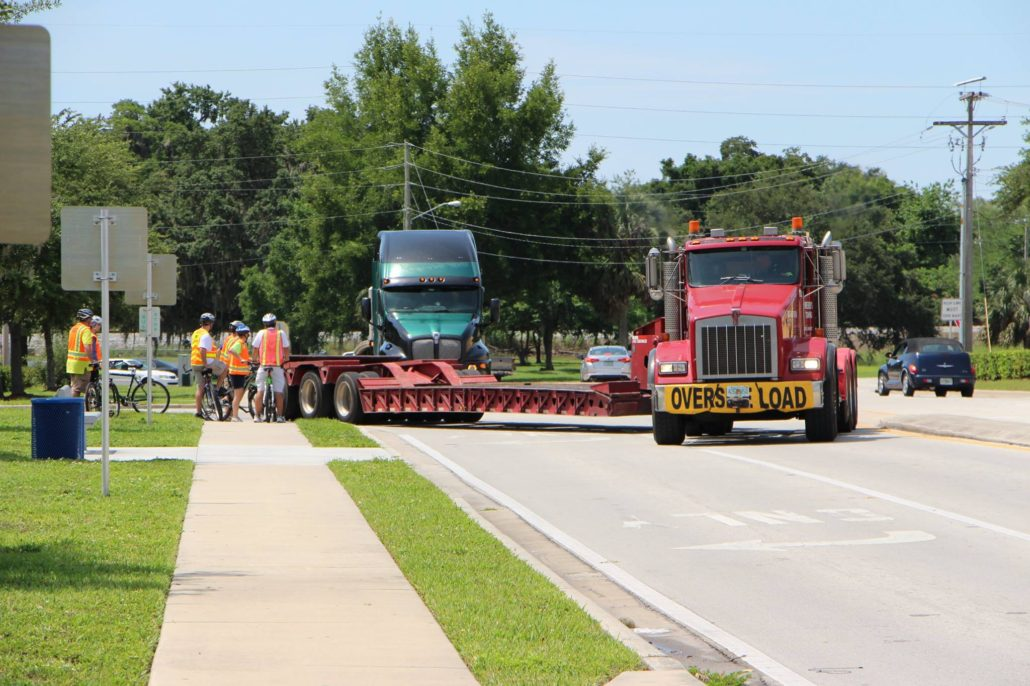 Big truck off-tracking onto sidewalk, within inches of FDOT staff standing on it!