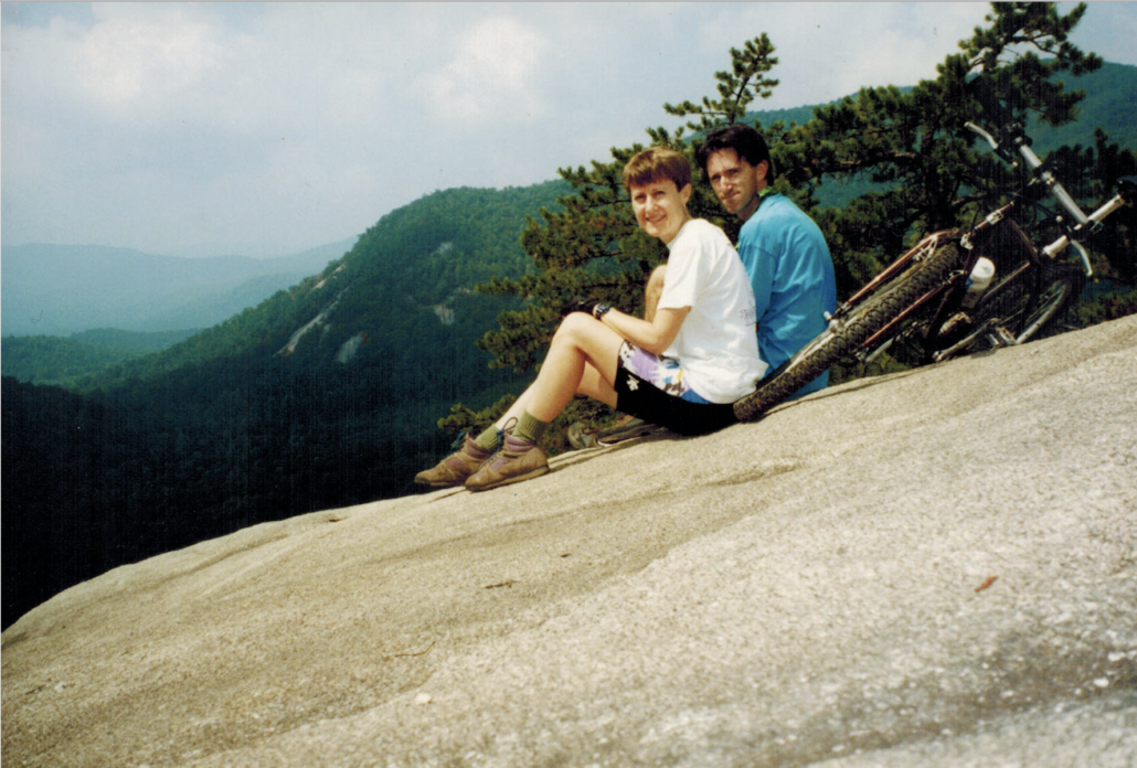 Photo of Carol and Mighk Wilson and their bicycles on a bald rock in DuPont State Forest in North Carolina.
