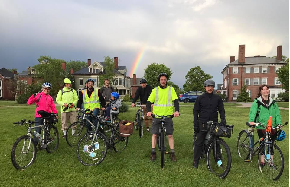 Photo showing rainbow over Portland Slow Ride in July 2017.