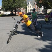 Gael Boucka of Allentown, PA, discovers the capabilities of his bike in Train Your Bike, CyclingSavvy's parking lot skills session.