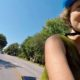 Karen Karabell riding bicycle on Kingshighway in St. Louis.