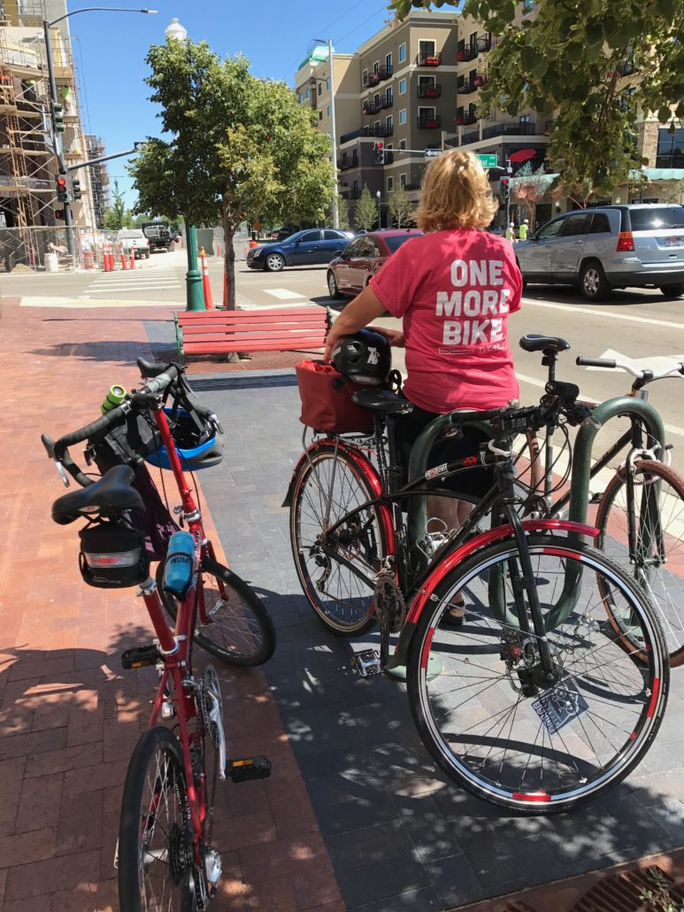 Lisa Brady in Downtown Boise with her bike and T-shirt's excellent message