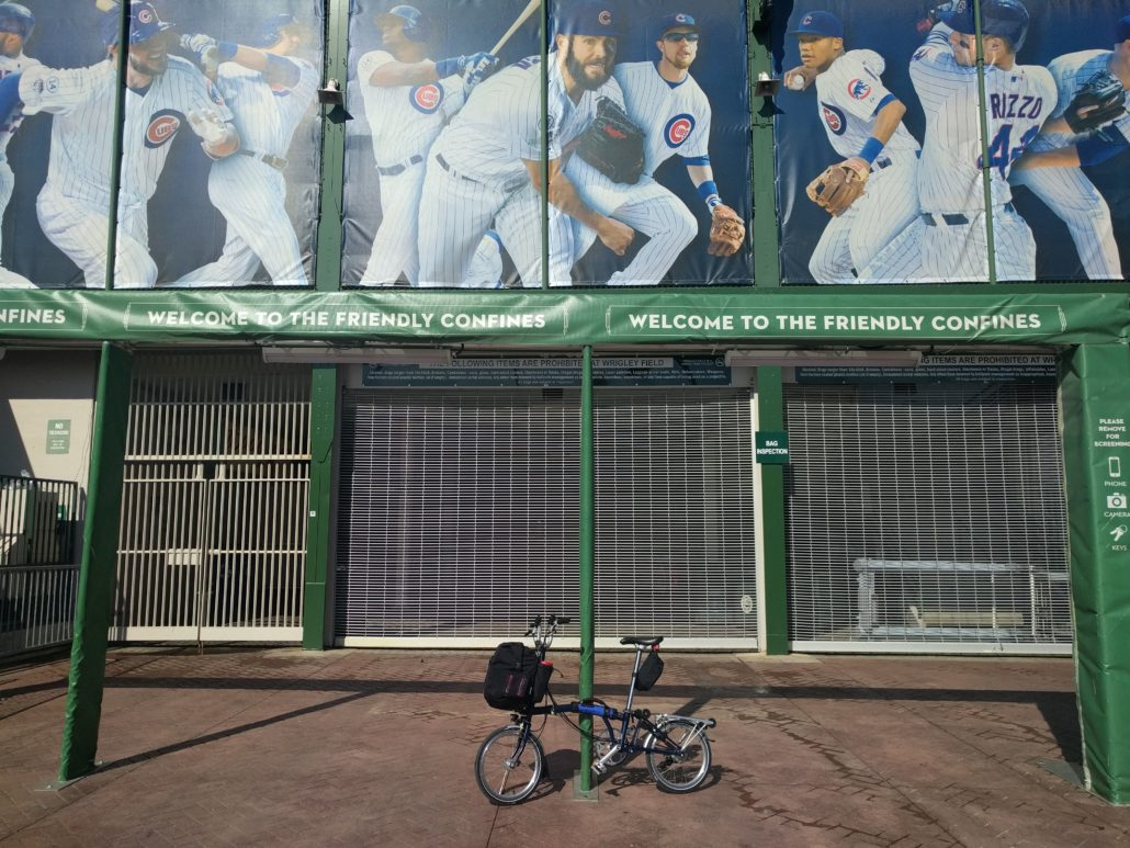 Brompton bicycle leaning on the gate to Wrigley Field.