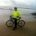 man and touring bike with ocean backdrop