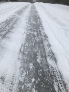 Bare tire tracks on snowy road