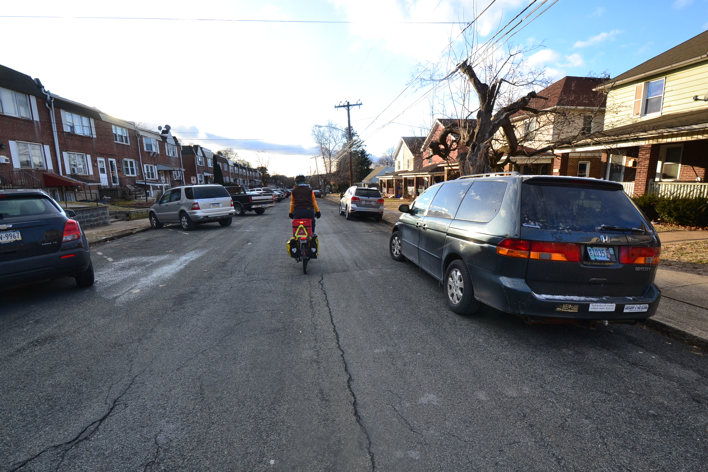view from rear of man cycling with daytime running lights