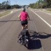 cycling using bicycle helmet mirror on wide open road