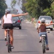 woman and child riding on road