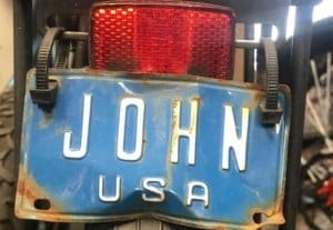"Blue bicycle license plate ""John"""