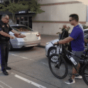 sergeant shows cyclist to never ride in door zone