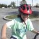 girl on bike with a big smile
