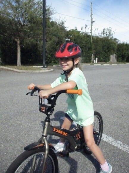 smiling girl on bike