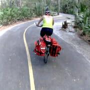 touring cyclist on curvy path