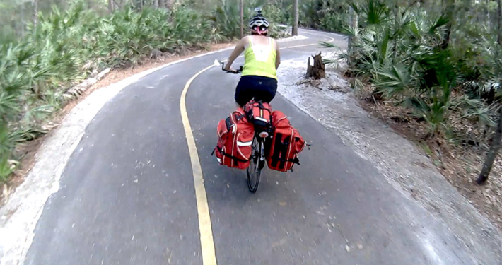 touring cyclist on curvy path