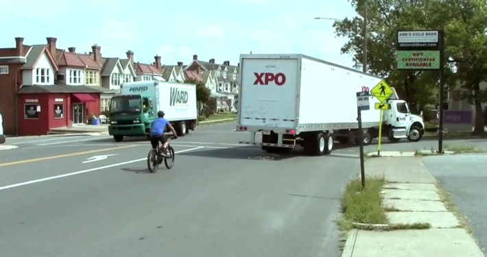 Cyclist safely passing large truck