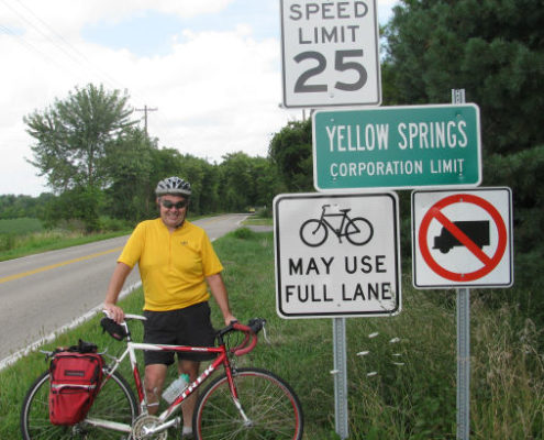Dan Carrigan and a BMUFL sign